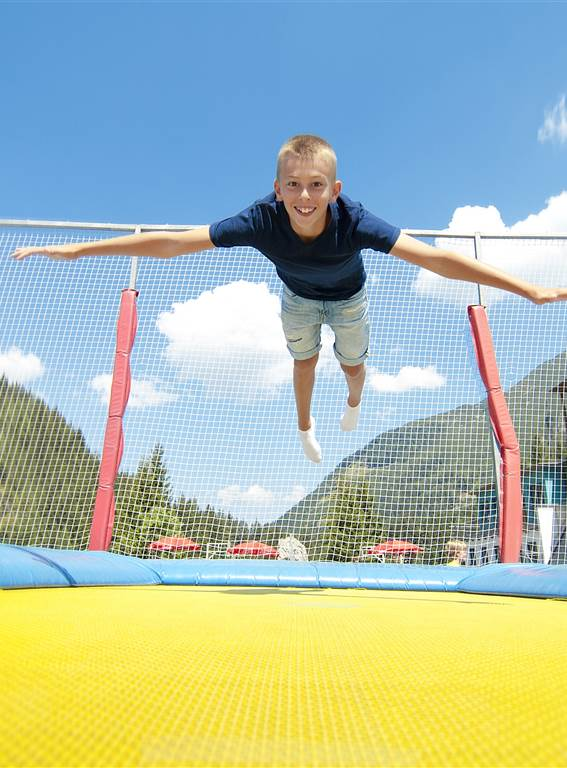 Child jumping on a trampoline